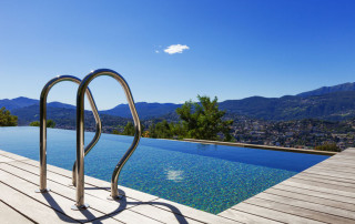 31652533 - grab bars ladder in the swimming pool, outdoor
