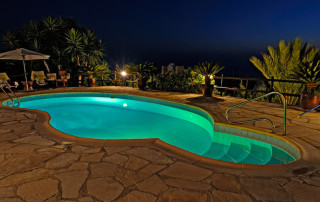 63416209 - swimming pool at holiday villa in cyprus at night with night lights