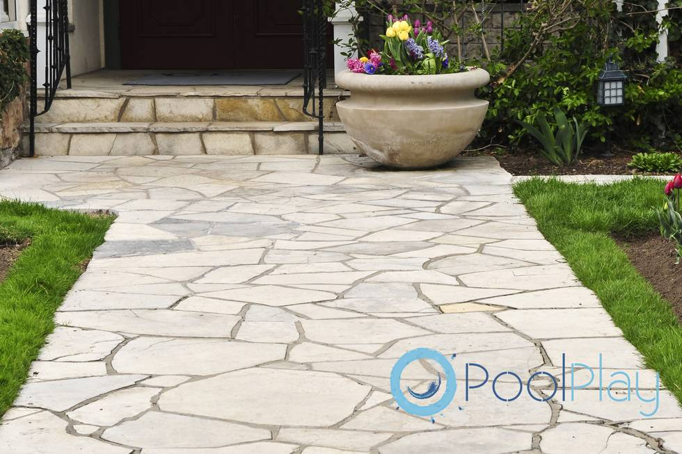 Natural stone path leading to a house, landscaping element