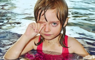 18335118 - little girl five years old learning to swim is afraid of water and have allergy on chlorine disinfection in water