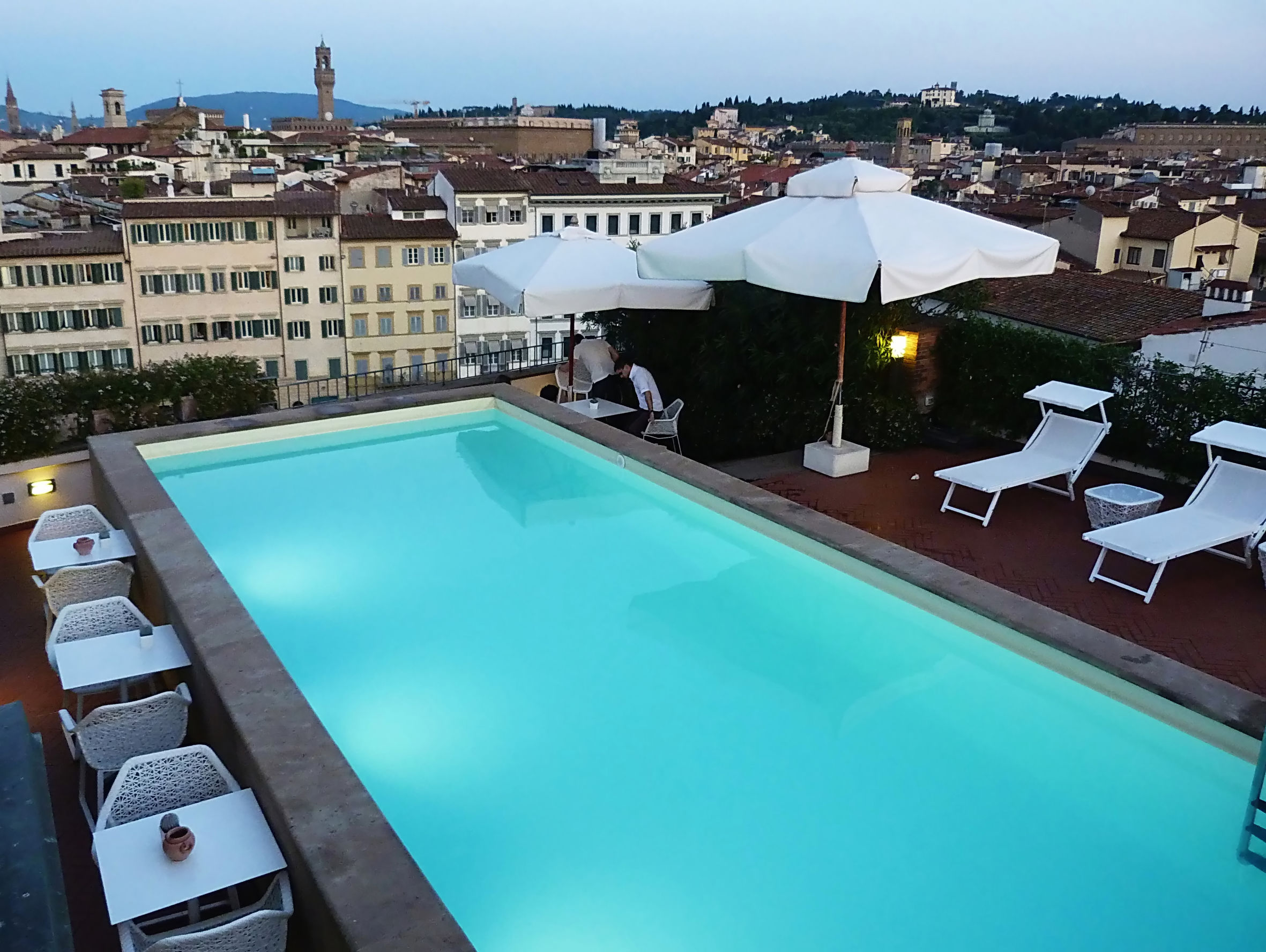 24620461 - view of florence from a rooftop with swimming pool, italy