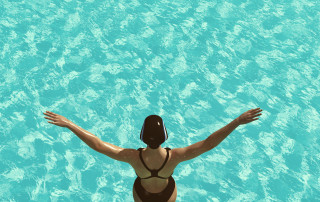 The young woman jumps from the trampoline into the water. This is a 3d render illustration