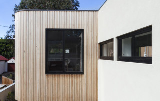 61586905 - close up of timber cladding slats on exterior renovation in australia