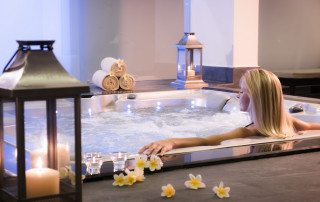 Spa theme .The girl relaxes in a jacuzzi