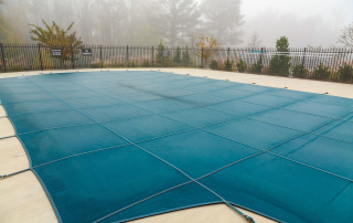 A Blue Vinyl Pool Cover in Fog